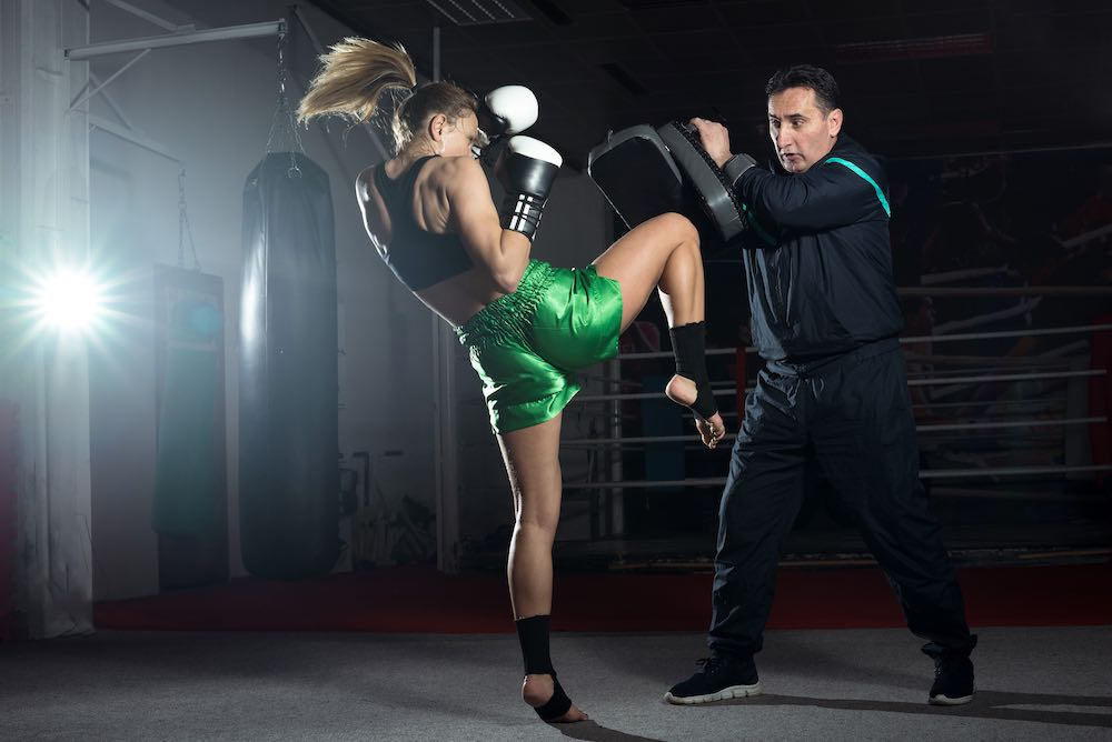 Kickboxing sparring with protective pads