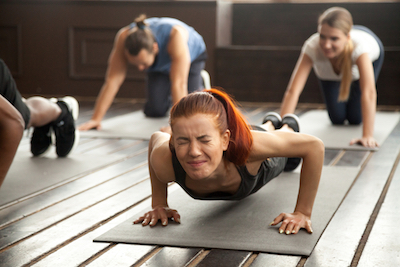 Female persevering through a tough workout